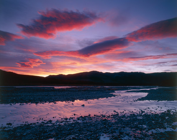 Solnedgång vid floden.