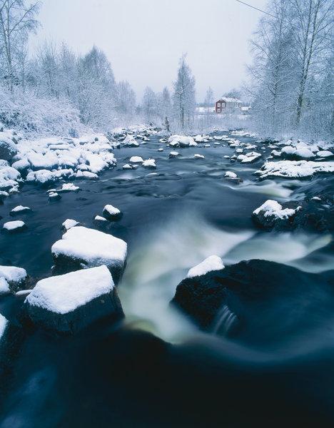 Vinterlandskap vid ån.
